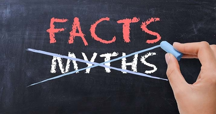 person crossing out myths and writing facts
