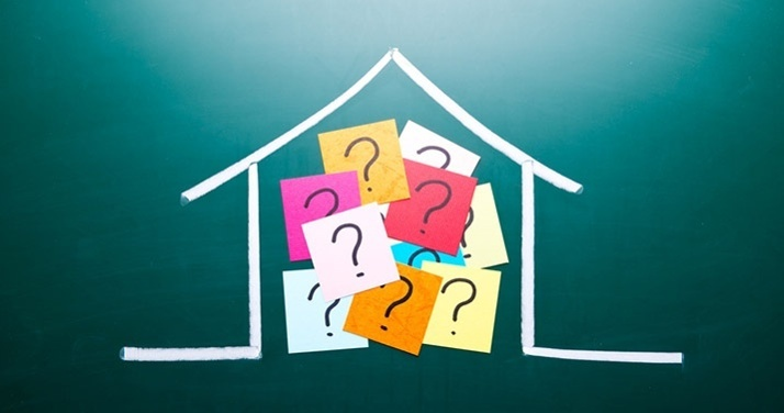 house and post it notes with question marks